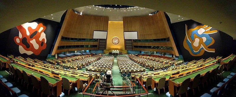 A panorama of the United Nations General Assembly, empty after the missiles fell