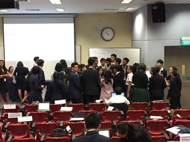 The Committee in an unmoderated caucus, having a heated discussion